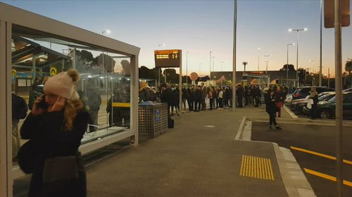 Commuters queued outside stations during peak hour in Melbourne tonight. (9NEWS)