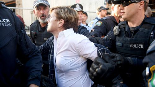 Christine Forster's jacket was ripped off in the ensuing chaos. (AAP)