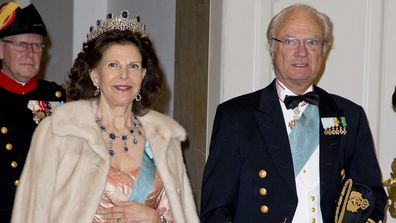Queen Silvia of Sweden and King Carl Gustaf of Sweden arrive for an event.