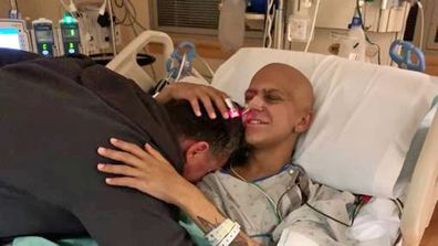 Ben Sylo travelled to the US last year to get a bone marrow transplant. Complications saw him placed on life support. Mr Sylo's stepfather Russell in pictured giving him a hug at his US hospital after he came off life support.