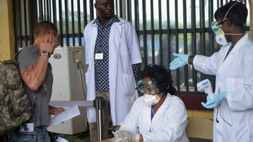 A passenger has a health check at Roberts International Airport in Ebola-hit Liberia. (Getty)
