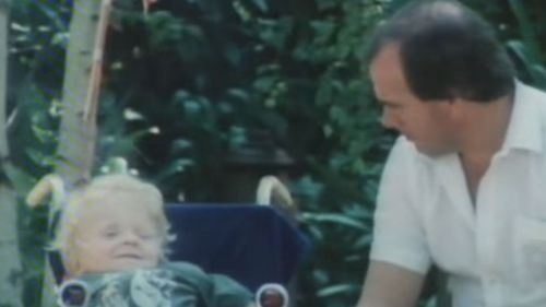 Quentin Kenihan as a child with journalist Mike Willesee.