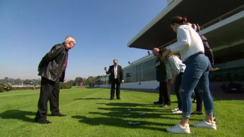 Flemington Racecourse in Melbourne is one of many locations participating in the two-up fun today. (9NEWS)