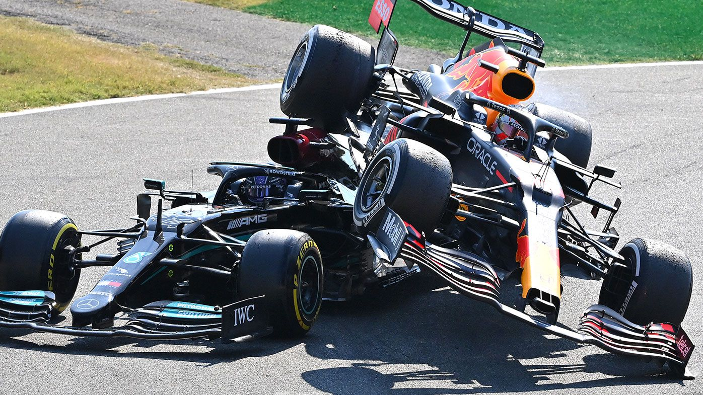 Max Verstappen of the Netherlands driving the (33) Red Bull Racing RB16B Honda and Lewis Hamilton of Great Britain driving the (44) Mercedes AMG Petronas F1 Team Mercedes W12 crash during the F1 Grand Prix of Italy at Autodromo di Monza on September 12, 2021 in Monza, Italy. (Photo by Peter Van Egmond/Getty Images)