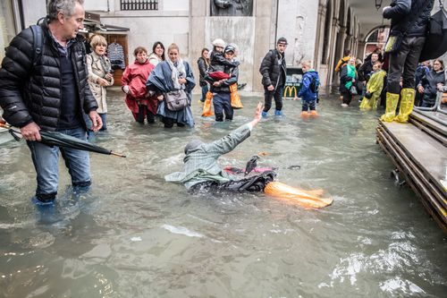 Parts of Venice are also completely submerged in water as floodwaters rise.
