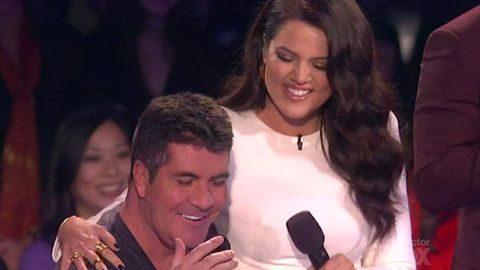 Simon Cowell gets 'excited' when Khloe Kardashian sits on his lap live on air