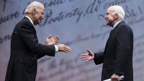 Sen. John McCain, R-Ariz., shakes hands with chair of the National Constitution Center's Board of Trustees, former Vice President Joe Biden after receiving the Liberty Medal in Philadelphia, Monday, Oct. 16, 2017