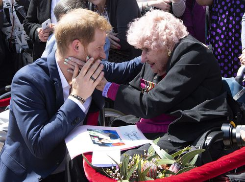 Daphne Dunne, a 98-year-old war widow who stole Harry's heart on two previous visits today met his wife Meghan.