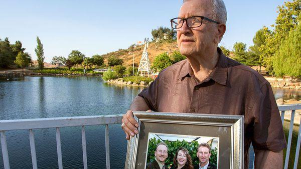 Frank J Kerrigan clutches photo of his children. Photo: AAP
