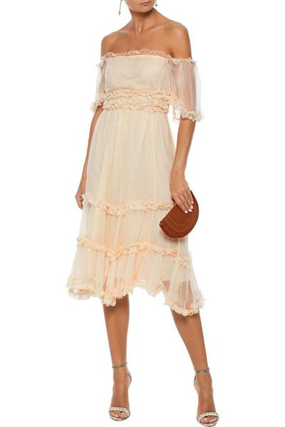 Add a touch of whimsical romance with a frock that is both feminine and modern