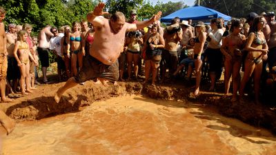 The Redneck Games have been held since 1996 and include events as iconic as toilet seat tossing, armpit serenades and mud belly flops.