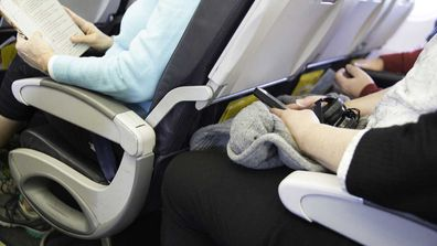 Woman reclines seat on plane