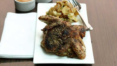 """<a href=""""http://kitchen.nine.com.au/2016/05/05/15/43/zaatarroasted-whole-baby-chicken-with-lemon-and-garlic-baked-potatoes"""" target=""""_top"""">Za'atar-roasted whole baby chicken with lemon and garlic baked potatoes</a> recipe"""