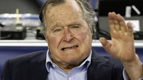 Former US president of the USA George HW Bush at a sports game