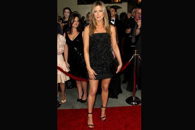 Everybody's looking at those legs! Enviably chic in a black mini at the 64th Annual Directors Guild Of America Awards.