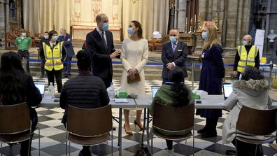 Prince William and Kate, Duchess of Cambridge speak to staff during a visit to the vaccination centre at Westminster Abbey, London, Tuesday, March 23, 2021 to pay tribute to the efforts of those involved in the Covid-19 vaccine rollout