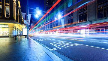 Sydney city traffic, night light trail, bus.