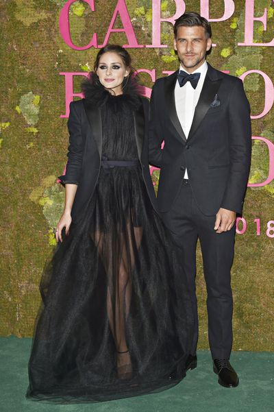 Olivia Palermo and partner Johannes Huebl both wear Italian label Tods in collaboration with ISKO Denim.