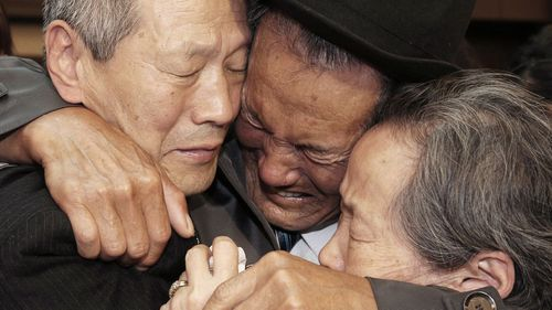 In this October 22, 2015, file photo, North Korean Son Kwon Geun, (centre), weeps with his South Korean relatives as he bids farewell after the Separated Family Reunion Meeting at Diamond Mountain resort in North Korea. (AAP)