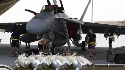 Explosives being loaded onto Australian fighter jets. (Picture: ADF)