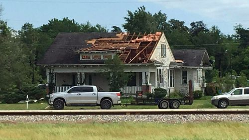 A roof is torn off a home following a suspected tornado in Franklin, Texas.