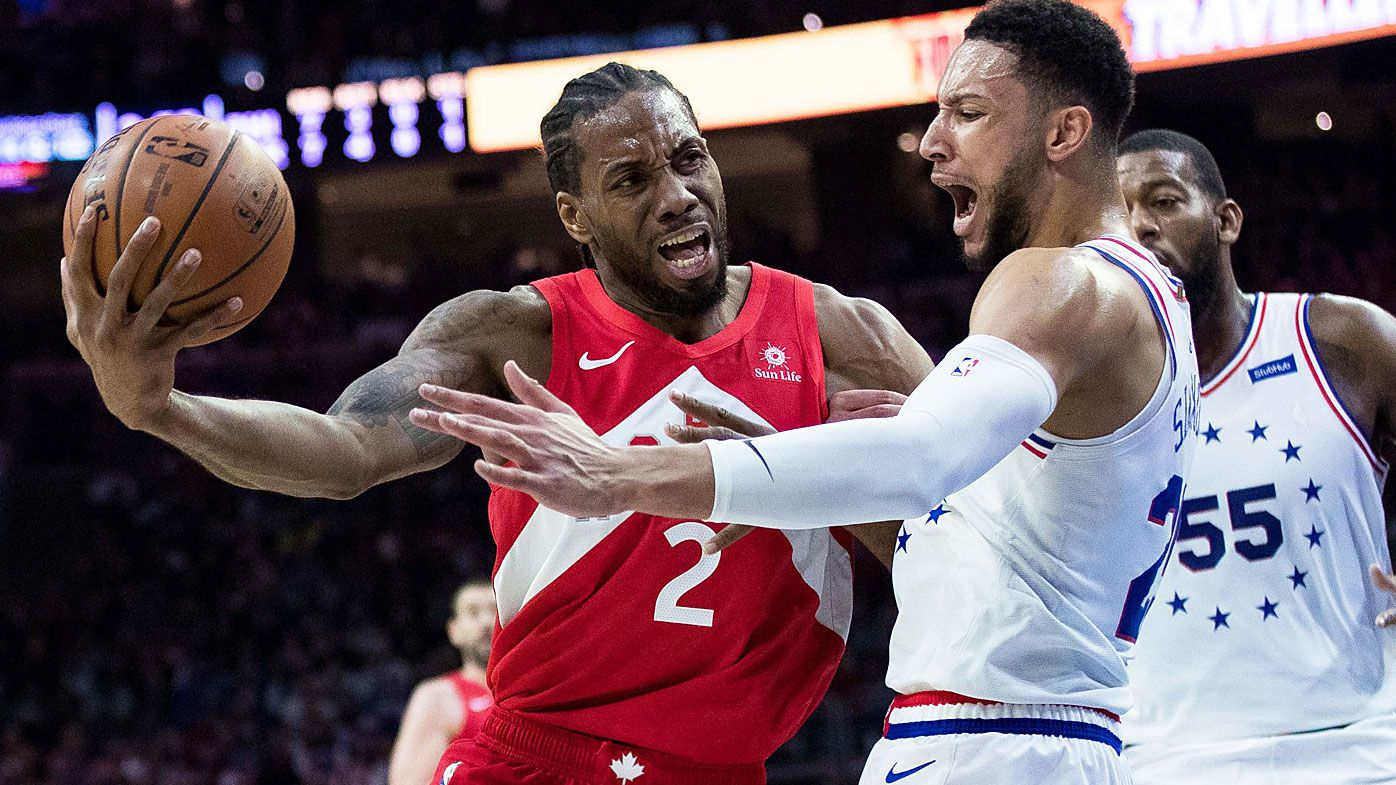 Toronto Raptors forward Kawhi Leonard (2) drives against Philadelphia 76ers guard Ben Simmons
