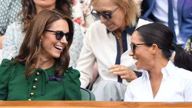 Catherine, Duchess of Cambridge and Meghan, Duchess of Sussex in the Royal Box on Centre Court during day twelve of the Wimbledon Tennis Championships at All England Lawn Tennis and Croquet Club on July 13, 2019 in London, England