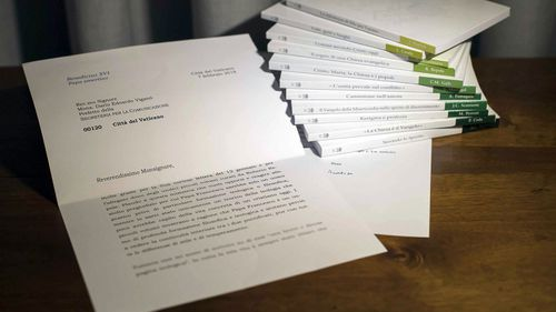 In this photo of a letter released by Vatican Media, retired Pope Benedict XVI praises a volume of books about the theological training of Pope Francis. The Vatican admitted Thursday, March 14, 2018 that it blurred the final two lines of the letter's first page,