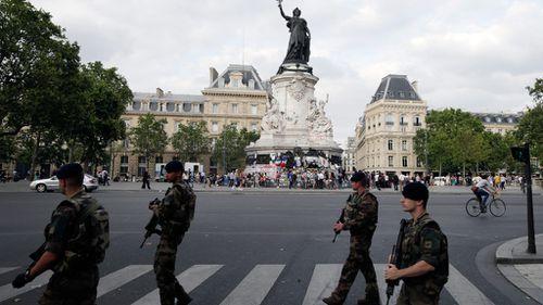 French soldiers walk past the place de la Republique's monument in Paris. (AFP)