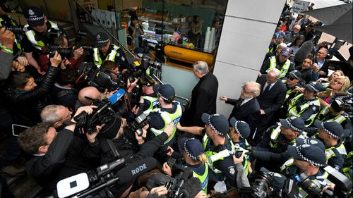 A crushing media scrum followed Cardinal Pell to his lawyers office following the court appearance.