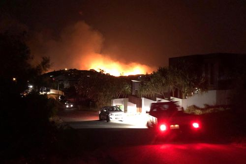 Hundreds of residents evacuated a bushfire in Peregian Springs, Queensland that were allegedly deliberately lit according to police.