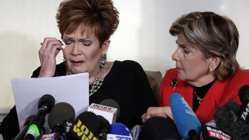 Beverly Young Nelson is comforted by lawyer Gloria Allred. (AAP)