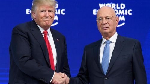 Donald Trump shakes hands with German Klaus Schwab, Founder and Executive Chairman of the World Economic Forum. (AAP)