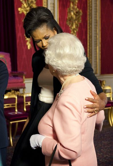 Michelle Obama broke royal protocol by embracing the Queen.
