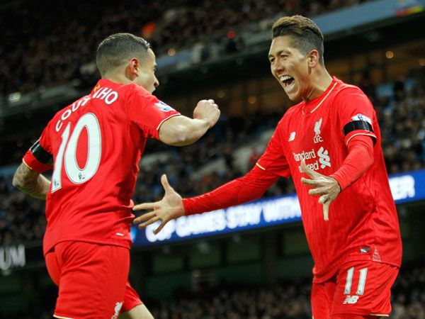 Philippe Coutinho and Roberto Firmino celebrate another goal. (AAP)