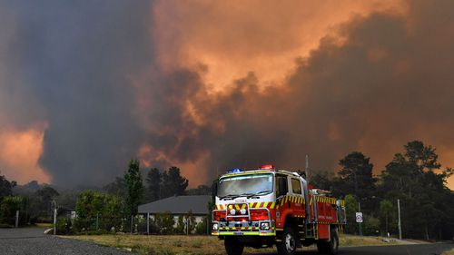 Rural Fire Service (RFS) crews prepare for the Green Wattle Creek Fire as it threatens homes in Yandeera in the south west of Sydney, Saturday, December 21, 2019. Temperatures in the 40's and high north westerly winds under extreme fire conditions are fanning a a number of fires around Sydney