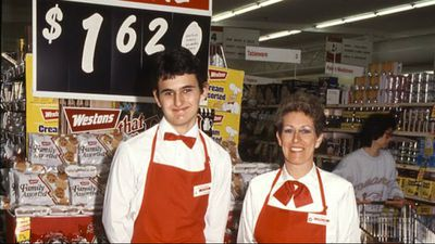 Staff smile for the camera at Woolworths Neutral Bay in 1987. Back then, a family packet of biscuits was $1.62  (Supplied)