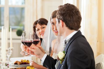 Guests at bride and groom table at wedding