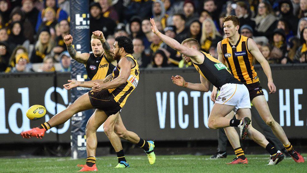 Hawks home, Mitchell reaches AFL milestone