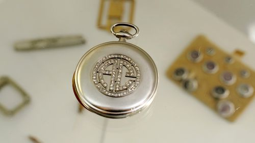 HOLD TO MOVE THURSDAY AUG 26 WITH STORY The platinum and diamond Patek Philippe pocket watch with the initials AC, that once belonged to mob boss Al Capone is seen on display at Witherells Auction House in Sacramento, Calif., Wednesday, Aug. 25, 2021. The watch is among the 174 family heirlooms that will be up for sale at an Oct. 8 auction titled A Century of Notoriety: The Estate of Al Capone, that will be held by Witherells in Sacramento. (AP Photo/Rich Pedroncelli)