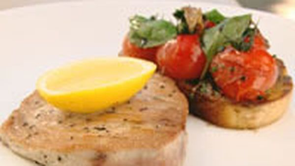 Seared tuna steak with sauteed tomatoes, basil toast and anchovy butter