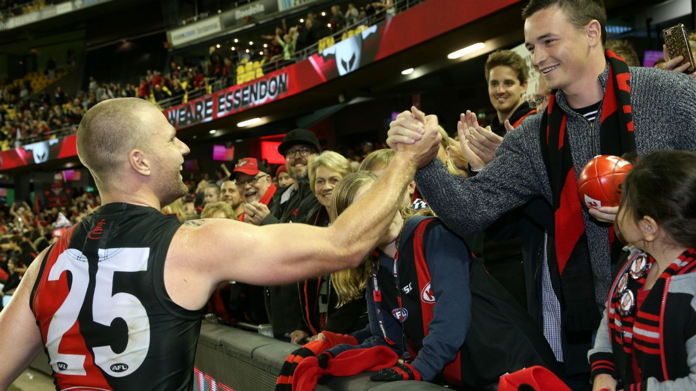 Jake Stringer of the Bombers celebrate with fans after the Round 4 AFL match between the Essendon Bombers and the Port Adelaide Power at Etihad Stadium in Melbourne, Sunday, April 15, 2018