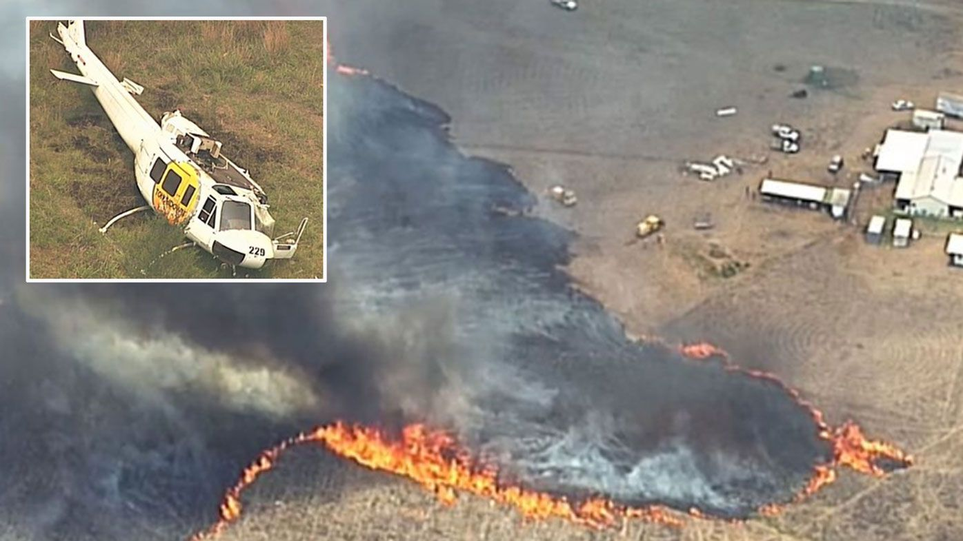 Chopper crashes as locals flee fast-moving blaze