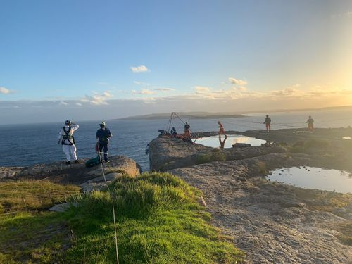 Rock climber airlifted to hospital with spinal injuries after 15m fall down cliff face in Beecroft Peninsula