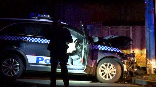 The patrol car crashed into a telegraph pole.