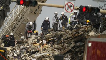 Miami building collapse loss 'too great to bear' as rescuers find children