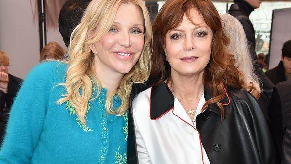 Courtney Love and Susan Sarandon in the Prada front row. Image: Getty