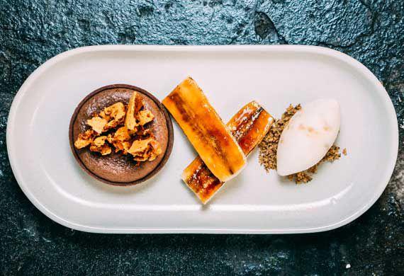 Gooey chocolate tart with caramelised banana, honeycomb and ice-cream