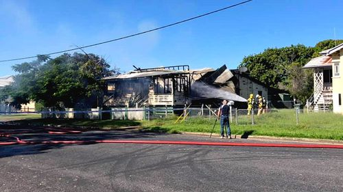 Authorities are investigating the fatal house fire after a man's boy was found at the back of the property.