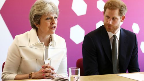 Prince Harry and British PM Theresa May met with delegates from across the Commonwealth. (AP/AAP)